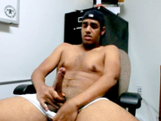 HOT Latino male masturbates at the office