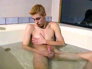 Hot guy strokes his cock in a jacuzzi