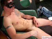 Tatooed muscle guy wanking his cock