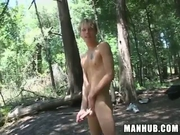 Cute blonde jerks his cock in the deep woods
