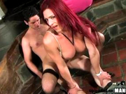 Redhead tranny with big tits &amp; ass fucks hard