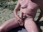 naked gay showing cock on the nudist beach