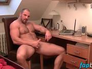 Muscular dude strokes his meaty tool