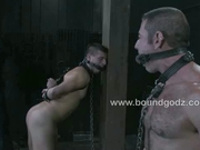 Horny hunks in gay bondage sex