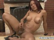 Foxy tranny strips and masturbates