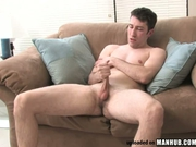 Straight hunk jerking solo on the couch