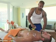 Fit black guy rubs down his bearded customer