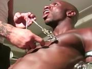 Ebony gay jock is at the mercy