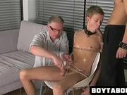Chained up hunk sucks cock