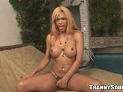 Blonde shemale beating her meat