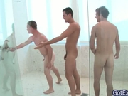Hot gay threesome having fun under