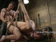 Josh flogs Adam and fucks him in bondage